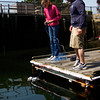 Gloucester: Sophie Palmer tries out her submersible remote operated vehicle with teacher Eric Sabo at the Maritime Heritage Center Thursday afternoon. Palmer who was working with 20 other Rockport Middle School students was the first to finish her ROV which she had been working on all week.  The students all spent their school vacation week at the Maritime Heritage Center thanks to a 3-year NOAA grant the Heritage Center received that's directly focused on environmental education for Rockport students.  Mary Muckenhoupt/Gloucester Daily Times