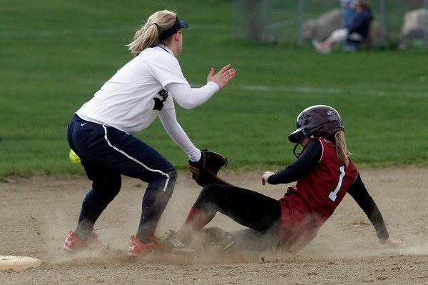 Gloucester: Gloucester's Krystina Novello slides safely into second base as Swampscott's Lindsey Marini misses the throw at Burnham Field yesterday afternoon. Photo by Kate Glass/Gloucester Daily Times