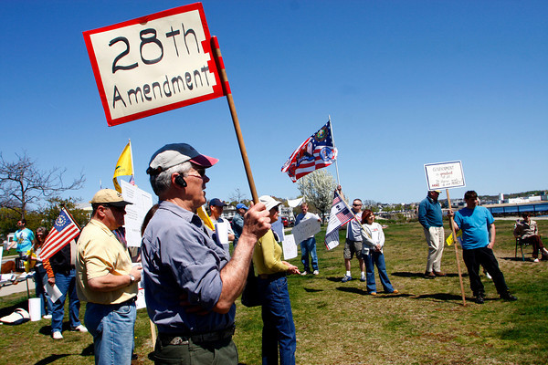 Gloucester: Larry Knight of Gloucester holds a sign at the Cape Ann Tea Party, a local chapter of the grass roots political organization, held on Stacy Boulevard Saturday afternoon.  Mary Muckenhoupt/Gloucester Daily Times