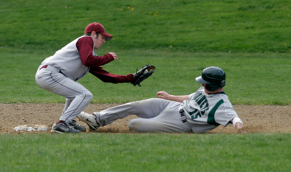 Rockport: Rockport's Pat Frithsen reaches to tag Manchester Essex's Alex Ray as he attempts to steal second base. Ray was called out. Photo by Kate Glass/Gloucester Daily Times