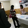 Gloucester: Denise Gadbois of Cape Ann Marina speaks with prospective employees during the Cape Ann Job Fair at the Masonic Temple yesterday morning. Cape Ann Marina, which is currently hiring for 6 positions, was one of 14 companies at the event. Photo by Kate Glass/Gloucester Daily Times