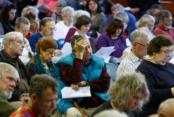 Rockport: Donald Buckley listens to Bob Visnick list the various expense item in the town during Rockport Town Meeting at Rockport High School Saturday. Mary Muckenhoupt/Gloucester Daily Times