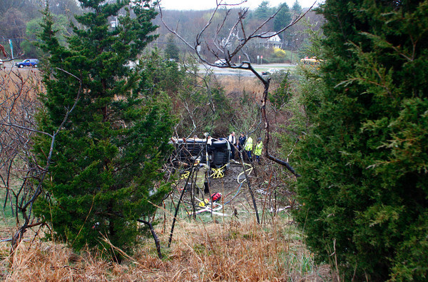Gloucester: A suv lost control on Rt. 128 and rolled down the embankment at exit 13 Friday afternoon. Mary Muckenhoupt/Gloucester Daily Times