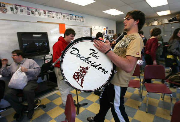 Gloucester: Nick Francis carries the bass drum from the Docksiders' drum kit through the music room to be packed for their trip to Hawaii. The band leaves on Friday at 3am. Photo by Kate Glass/Gloucester Daily Times