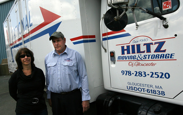 Gloucester: Jane Hiltz Carpenter and her husband, Marshall, owners of Hiltz Moving and Storage, stand near one of their trucks, which now has a new logo due to its new affiliation with National Van Lines. Photo by Kate Glass/Gloucester Daily Times