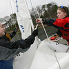 Manchester: Natalie Warren, Connor Winn, and Julia Melamed hoist the sails as they head out with the Manchester Essex sailing team yesterday afternoon. Photo by Kate Glass/Gloucester Daily Times
