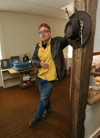 Gloucester: Henry Ferrini stands in the former home of his uncle, Gloucester poet Vincent Ferrini, on East Main Street. Ferrini is hoping to open the home as a writing center. Photo by Kate Glass/Gloucester Daily Times