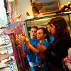 "Gloucester: Fifth grade students from Beeman Elementary school hang jelly fish made from balloons, paper and ribbons at the Halibut Point State Park Visitor's Center Friday morning. The fifth grade classes decorated the visitor's center with art work left over form the ""Living Blue"" Marine science exhibition that was held at the elementary school Thursday.  Pictured from left is Nicole Tocco, Melissa Laurie, Alexis MacLean, back, Nicolette Mason and Alexis Raymond.  Mary Muckenhoupt/Gloucester Daily Times"