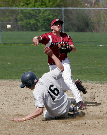 Gloucester: Gloucester's Caulin Rogers tries to turn two, but only gets Winthrop's Mike McCarthy out at second base during their 10-0 win yesterday morning. Photo by Kate Glass/Gloucester Daily Times