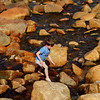 Rockport: Nate Miller, 4, carefully climbs over the rocks at Front Beach while making his way back over to his mother Wednesday afternoon. Mary Muckenhoupt/Gloucester Daily Times