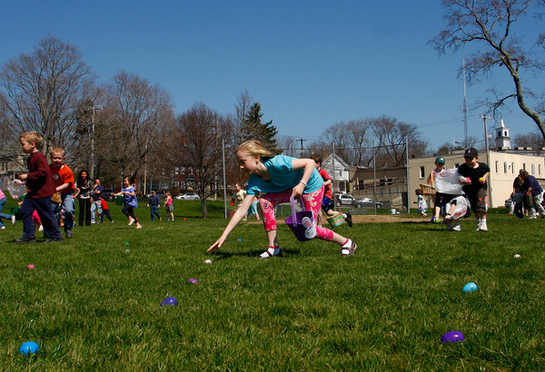 Essex: Emily Andrews, 8, quickly picks up an egg during the annual Easter egg hunt at Memorial Field Saturday afternoon.  After the egg hunt kids could meet the Easter Bunny and have their face painted with a pink nose and whiskers. Mary Muckenhoupt/Gloucester Daily Times
