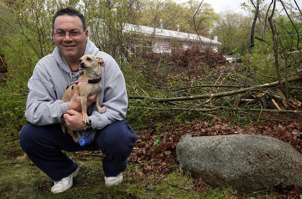 Gloucester: Ed McCollum's chihuahua, Cheeka, alerted him to a car that flipped over into the bushes in his front yard on Poplar Street Tuesday night. McCollum said he heard a loud crash and went outside to investigate, but did not see anything in the dark. Cheeka did not stop barking and eventually led him to the car where a woman was trapped inside. Photo by Kate Glass/Gloucester Daily Times