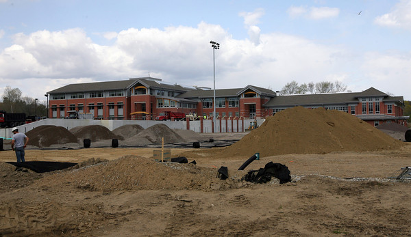 Manchester: The Manchester Essex Regional High School recently received a good review from a school assessment panel, especially for its new building. Work on the athletic field and main entrance is still ongoing. Photo by Kate Glass/Gloucester Daily Times