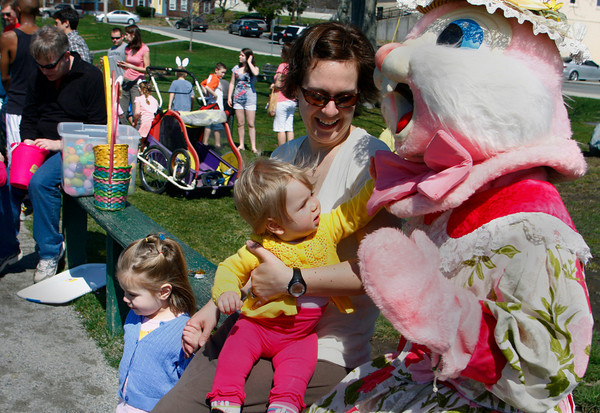 Essex: Helen Moody, 9 months, checks out the Easter Bunny for the first time while posing for a photo with her mother Elizabeth and sister Alice, 2, after the Easter egg hunt at Memorial field in Essex Saturday afternoon. Mary Muckenhoupt/Gloucester Daily Times