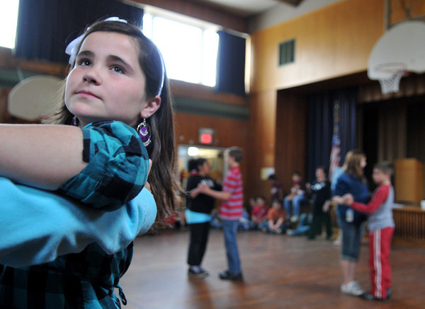 Gloucester: Alexis Raymond 11, is focused on the start of the Tango with partner Austin Church,out of frame at the Beeman School Wednesday morning. The Students pratice for the up coming Mad Hop Ball lead by Miss Tina's School of Dance. Desi Smith Photo/Gloucester Daily Times. April 28,2010.