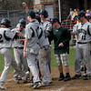 Rockport: Keith Leavitte's teammates greet him as he crosses home plate following a solo home run in the 5th inning of Manchester Essex's game at Rockport yesterday. Photo by Kate Glass/Gloucester Daily Times