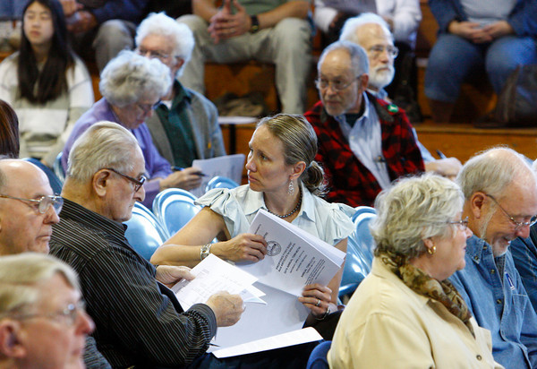 Rockport: Laura DeLuca, center, listens to Herb Wescott speak at one of the microphones during Rockport Town Meeting at Rockport High School Saturday morning. Mary Muckenhoupt/Gloucester Daily Times