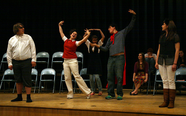 "Rockport: Ben Tuck, far left, and Emily Ohrtman, far right, watch as Cassie Balzarini, Marabah Akers, and Nathan Cruz perform a dance during a rehearsal for Rockport High School's production of ""The 25th Annual Putnam County Spelling Bee,"" which will run May 6-8. Photo by Kate Glass/Gloucester Daily Times"