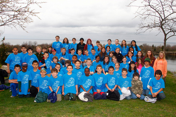 """Rockport: The three fifth grade classes from Beeman Elementary School pose for a picture at Halibut Point State Park in Rockport Friday.  The students came to decorate the park's visitor's center with handmade decorative artwork left over from their """"Living Blue' marine science exhibition held at school Thursday night. Mary Muckenhoupt/Gloucester Daily Times"""