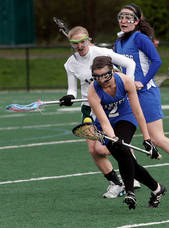 Manchester: Danvers' Caroline Cratean scoops up the ball as Manchester Essex's Grace Gillette chases her down at Coach Ed Field Field in Manchester yesterday afternoon. Photo by Kate Glass/Gloucester Daily Times