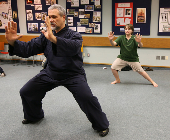Gloucester: Paul DiCrescenzo demonstrates Movements of the Tiger in Bai Long Quan Kungfu at the Sawyer Free Library on Thursday night as Audie Tarr, rear, mimics his movements during a free program sponsored by the Institute of Museum and Library Services, the Library Services and Technology Act, and the Massachusetts Board of Library Commissioners. Photo by Kate Glass/Gloucester Daily Times