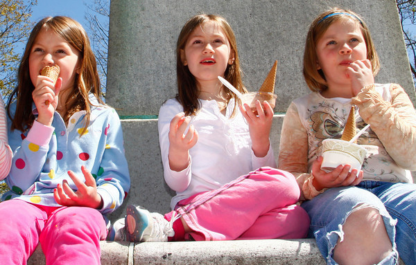 Manchester: From left, Camilla Johnson, 6, Whitney Johnson. 7, and Naomi Franklin, 7, enjoy some ice-cream on a warm spring day at Masconomo Park Thursday afternoon.  Mary Muckenhoupt/Gloucester Daily Times