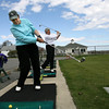 Gloucester: Gerry Sullivan and Lois Dagle tee up at the Bass Rocks Country Club yesterday afternoon. The two were practicing their swing to get ready for golf season. Photo by Kate Glass/Gloucester Daily Times
