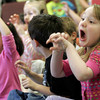 "Rockport: Eliza Smith, right, and Mya Doucette act like lions as a chamber group from Rockport Music performs ""Carnival of the Animals"" by Camille Saint-Saens at Rockport Elementary School yesterday morning. Photo by Kate Glass/Gloucester Daily Times"