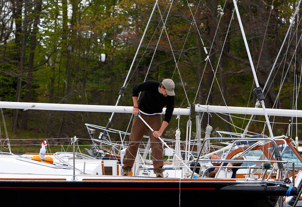 Manchester: Joe Dion washes the deck of a sailboat at Crocker's Boat Yard Thursday afternoon. Mary Muckenhoupt/Gloucester Daily Times