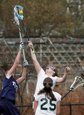 Manchester: Manchester Essex's Molly Friedman and Triton's Sara Nardone leap for the ball during their game at Coach Ed Field Field yesterday. Photo by Kate Glass/Gloucester Daily Times