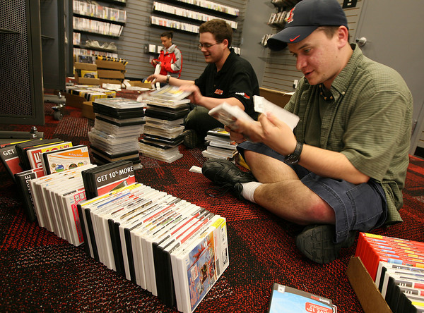 Gloucester: Jared Mountain, right, of Gloucester and James Davekos of Hamilton price pre-owned games at GameStop in Gloucester Crossing. The store, which opens on Thursday, is one of several stores opening in the next phase of the development. Photo by Kate Glass/Gloucester Daily Times