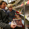 Essex: Margaret Sweet and her son, Graham, 3, look at books for sale at Essex Elementary School's Scholastic Book Fair. The book fair, which was held throughout the week, was a fundraiser for the school. Photo by Kate Glass/Gloucester Daily Times