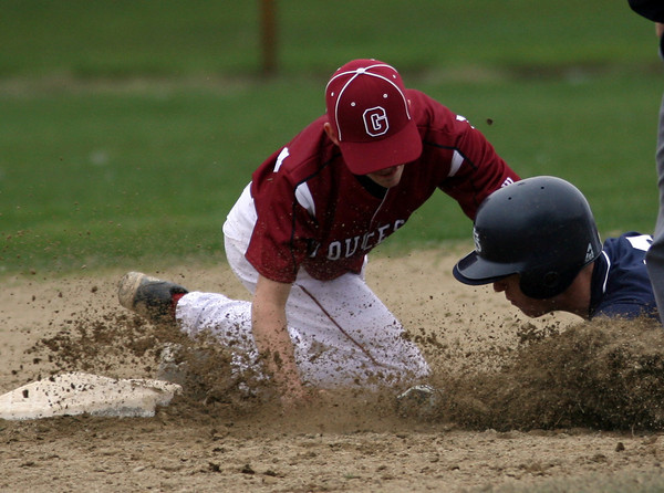 Gloucester: Gloucester shortstop MacKenzie Quinn tags St. John's Prep's Dillon Gonzalez out at second during the Fishermen's 7-6 win over the Eagles yesterday. Photo by Kate Glass/Gloucester Daily Times