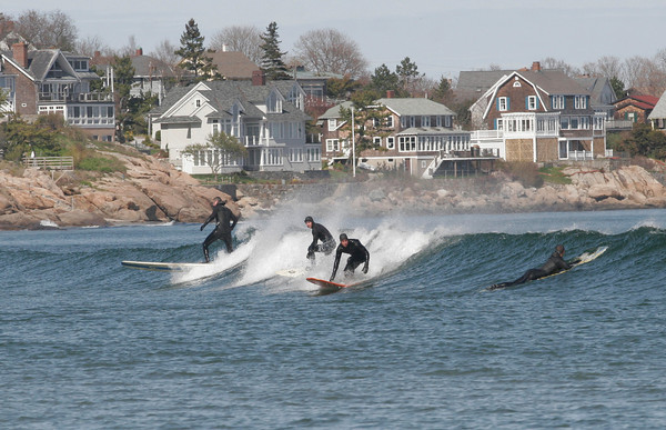 Gloucester: Many surfers flocked to Good Harbor Beach on Monday for the steady waves rolling ashore. Photo by Kate Glass/Gloucester Daily Times