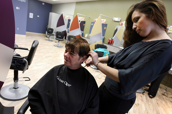 """Gloucester: Mary Orlando of Gloucester gets her hair cut by Liz Rabbitt of Gloucester at Great Clips, which recently opened in Gloucester Crossing. Orlando, who celebrates her 55th birthday on Saturday, wanted something """"funky and chunky."""" Photo by Kate Glass/Gloucester Daily Times"""