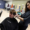 "Gloucester: Mary Orlando of Gloucester gets her hair cut by Liz Rabbitt of Gloucester at Great Clips, which recently opened in Gloucester Crossing. Orlando, who celebrates her 55th birthday on Saturday, wanted something ""funky and chunky."" Photo by Kate Glass/Gloucester Daily Times"