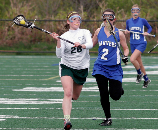 Manchester: Manchester Essex's Hannah Beardsley keeps ahead of Danvers' Caroline Cratean at Coach Ed Field Field yesterday afternoon. Photo by Kate Glass/Gloucester Daily Times