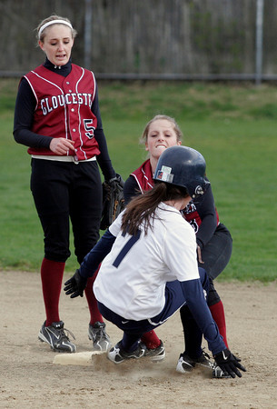 Gloucester: Erin Jermyn tags Swampscott's Heather Doyle out as she attempts to steal second base while teammate Alysha Clayton comes in for backup at Burnham Field yesterday afternoon.