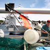 Gloucester:  Craig Walker, a member of the crew aboard the Foxy Lady gets the boat ready to head out Friday afternoon. Mary Muckenhoupt/Gloucester Daily Times