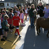 "Essex: Faith, a miniature horse, leads the way to Essex Elementary School yesterday morning as dozens of students form a ""walking school bus"" to the school from the police station. The walking school bus has been ongoing for a few years, but was suspended during the winter months because of inclement weather. Photo by Kate Glass/Gloucester Daily Times"