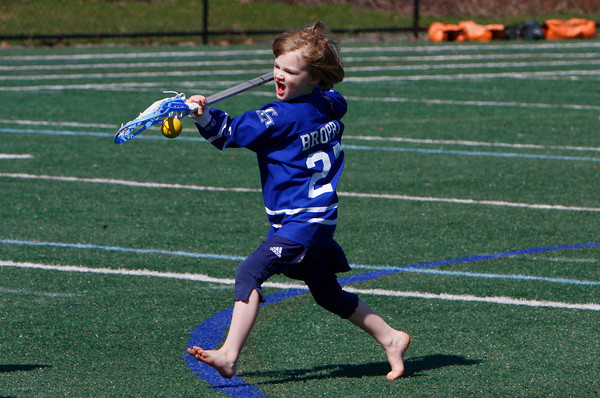Manchester: Julia Brophy, 4, tries to craddle the ball while playing lacrosse with her dad and cousins at Coach Ed Field Field Friday afternoon. Mary Muckenhoupt/Gloucester Daily Times