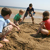 Manchester: Griffin Murphy, Cole Murphy, Jack Murphy, and Lena Hurley build a sand house at Singing Beach Thursday afternoon. Photo by Kate Glass/Gloucester Daily Times