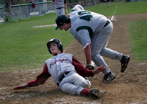 Rockport: Rockport's Derick MacDowell slides safely across home plate as Manchester Essex pitcher Tim Surette did not get the tag in time. Photo by Kate Glass/Gloucester Daily Times