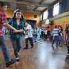 Gloucester: Partners Ryan Gabriele 11, and  Alexis Raymond 11, dance the swing along with other students, at the Beeman School Wednesday morning. The Students pratice for the up coming Mad Hop Ball lead by Miss Tina's School of Dance. Desi Smith Photo/Gloucester Daily Times. April 28,2010.