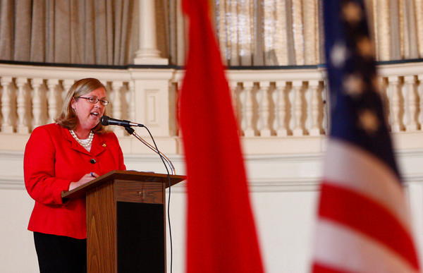 Gloucester: Gloucester Mayor Carolyn Kirk addresses the crowd of new American citizens at the Naturalization Ceremony at Gloucester City Hall Thursday afternoon. Mary Muckenhoupt/Gloucester Daily Times