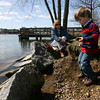 Manchester: Stephanie Senecal watches as her grandson, Robert Silverstein, tosses rocks into Manchester Harbor yesterday afternoon. Robert is visiting from Connecticut for ten days. Photo by Kate Glass/Gloucester Daily Times