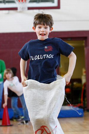 Rockport: Michael Newman jumps in a potato sack race at the Kangaroo Hop staion of the Australian Olympics at the Rockport Elementary School Thursday afternoon.  The second grade classes participated in the Australian olympics which included a Dingo Dash, Gum Tree Climbing and Ayer Rock Climbing. Mary Muckenhoupt/Gloucester Daily Times