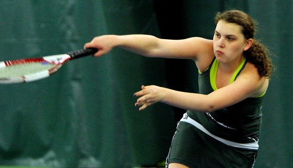 ALLEGRA BOVERMAN/Staff photo. Gloucester Daily Times. Manchester: Manchester-Essex's second singles player Kendall McCormick, in action against Triton's Alexa Bryant during their match at Manchester Athletic Club on Monday.
