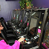 ALLEGRA BOVERMAN/Staff photo. Gloucester Daily Times. Gloucester: Lucky 7 Arcade Manager Janine Brooks, standing, chats with Christel Nelson of Gloucester, at the arcade on Wednesday. Brooks' parents, the owners, have recently opened a new location in Liberty Tree Mall.
