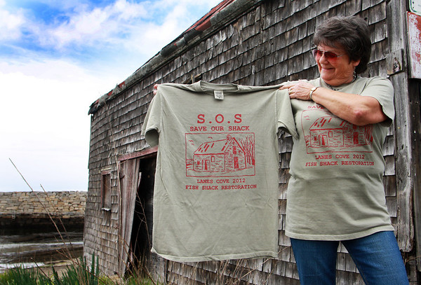 Barbara Jobe of Lanesville sports a new T-shirt disigned to raise both finances and awareness for an effort to restore the historic Scandinavian fish shack at Lane's Cove. These shirts can be purchased at Woola on Washington Street in Lanesville. Jesse Poole/Gloucester Daily Times April 12, 2012